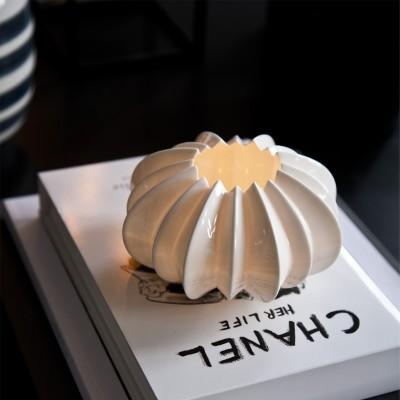 Teelicht in Sternform aus feinem Porzellan
